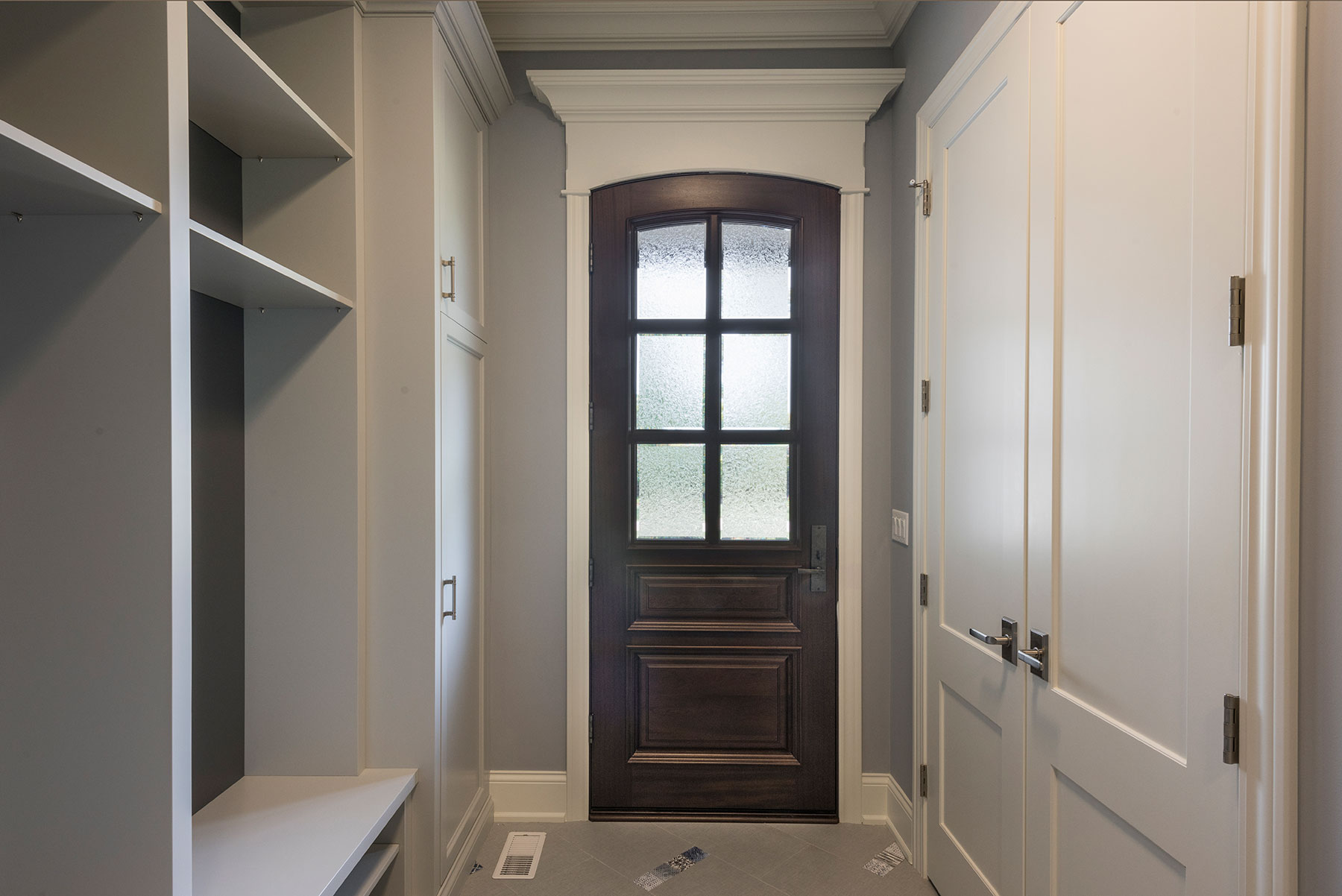 Custom Wood Front Entry Doors | hallway view of solid wood mudroom entry door  DB-652W - Glenview Doors - Custom Doors in Chicago