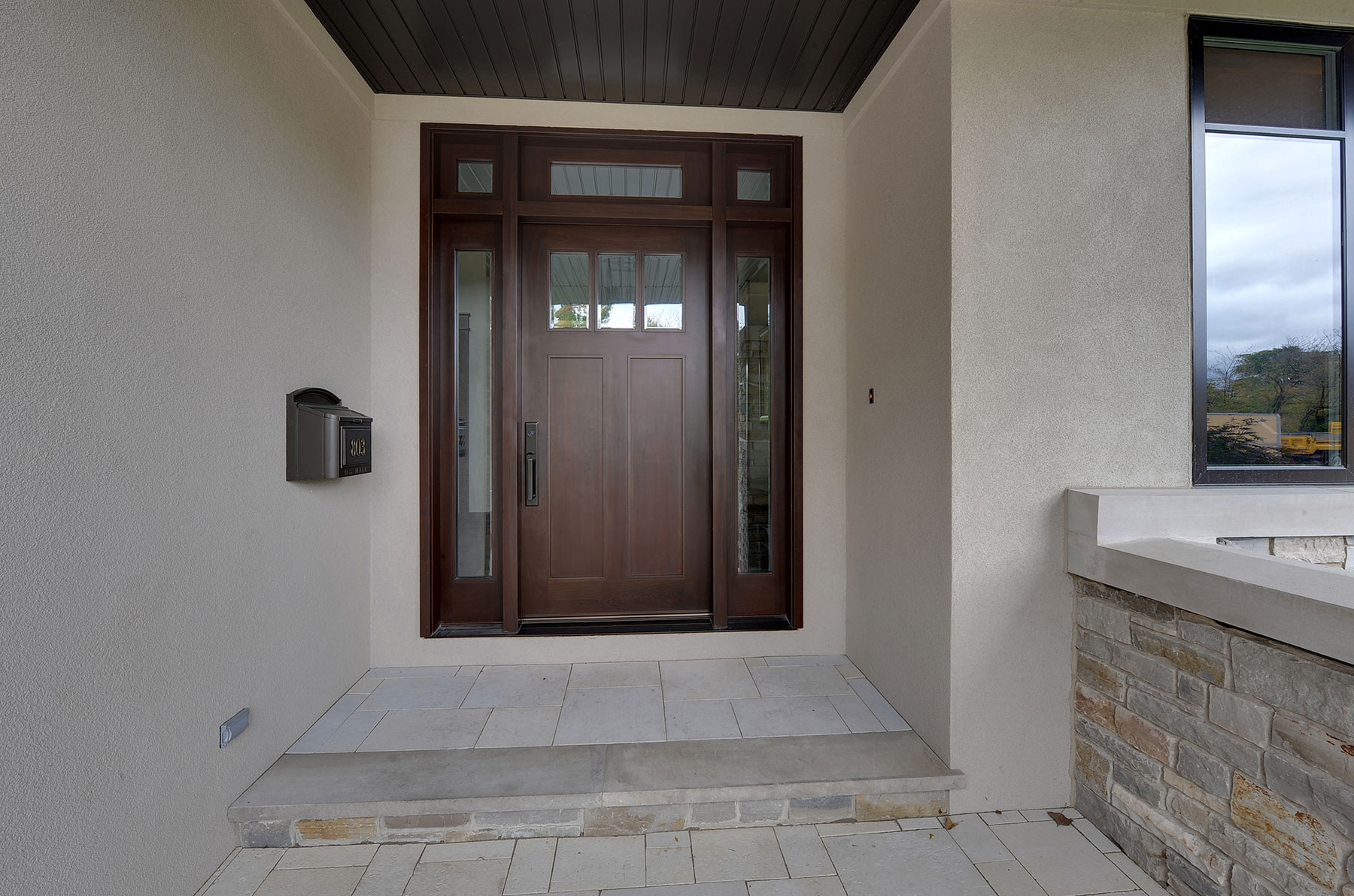 Custom Wood Front Entry Doors | Custom Craftsman Solid Mahogany Wood Door with Sidelites and Transom with Clear Beveled Glass, Exterior View  - Glenview Doors - Custom Doors in Chicago