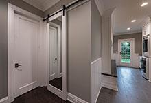 Custom Wood Interior Doors - paint grade barn door with mirror.
