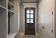 Custom Wood Front Entry Doors - hallway view of solid wood mudroom entry door . DB-652W