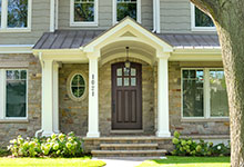 Custom Wood Front Entry Doors - privacy glass on arched top single entry door, in dark finish. DB-012WA