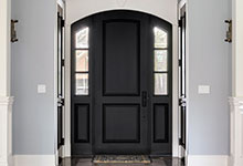 Custom Wood Front Entry Doors - two panel arched top door with sidelites.