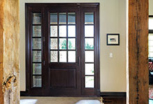 Custom Wood Front Entry Doors - interior view of solid wood front entry door, clear glass, dark finish.