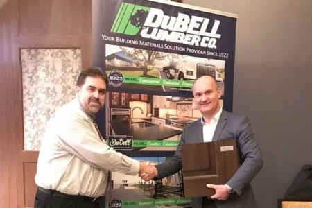 Glenview Doors Founder and CEO shakes hands with Dubell Lumber Marketing and Technology Manager Ed Evans